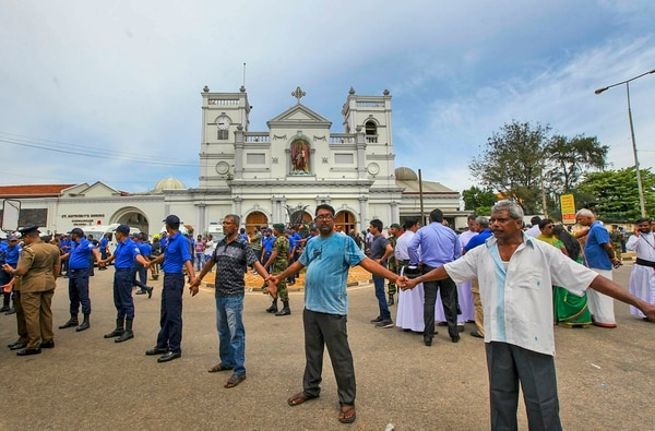 In this Sunday, April 21, 2019, photo, Sri Lankan army soldiers secure the area around St. Anthony's Shrine after a blast in Colombo, Sri Lanka. Sri Lankan authorities blame seven suicide bombers of a domestic militant group for coordinated Easter bombings that ripped through Sri Lankan churches and luxury hotels which killed and injured hundreds of people. It was Sri Lanka's deadliest violence since a devastating civil war in the South Asian island nation ended a decade ago. (AP Photo/Rohan Karunarathne)