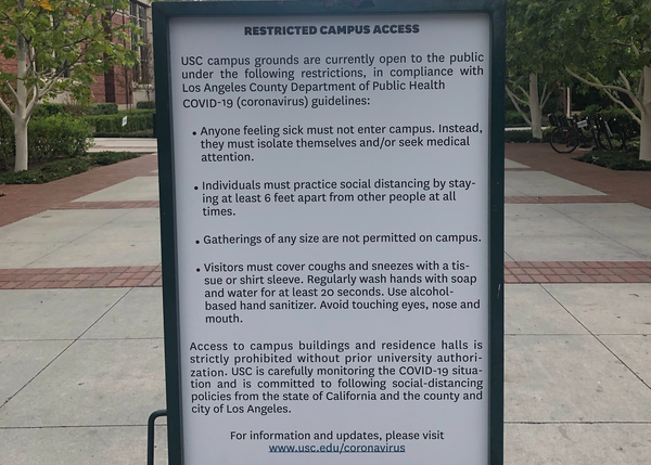 Signs were placed outside of the University Village, reminding the public of new restrictions on the public's access to campus.