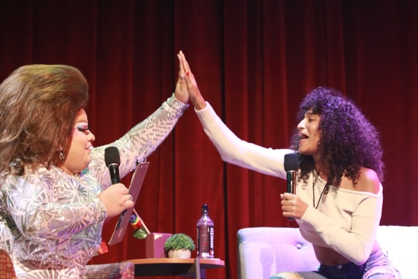 Angel Dust and Inyda Moore share a moment when talking astrology a Bovard Auditorium on Oct 3. (Photo by Mia Hairston)