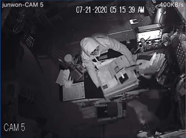 Security camera footage capturing robbers stealing the cash register. (Image courtesy of Jeff Jun)