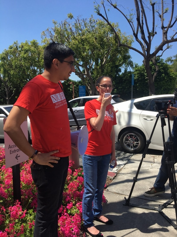 Tanya Valuz, a therapist at Kaiser's Pasadena Clinic, speaks during the strike. (Jon Reed)