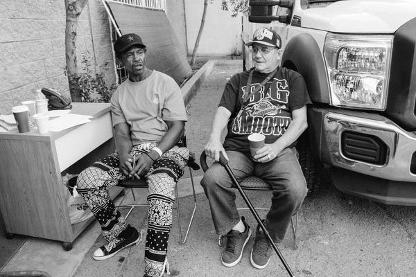 General Dogon talks politics with a formally homeless man named Al