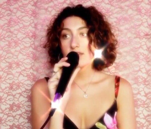 Natasha Nutka poses with a microphone. (Image courtesy of Natasha Nutka @thriftylion)