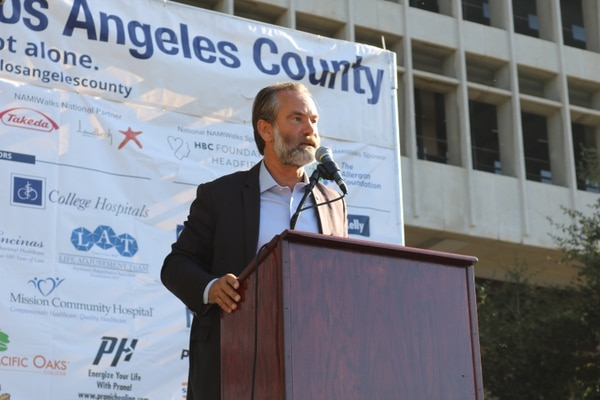 LA County Department of Mental Health Director Dr. Jonathan Sherin opened the event with a speech promoting Senate Bill 10. (Photo by Dan Toomey)