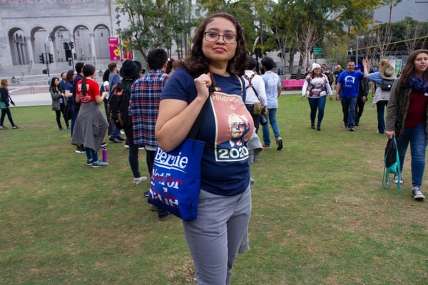 "Sanders supporter Erika Garcia wears a shirt that says ""Hindsight is 2020."" (Annenberg Media / Morgan Stephens)"