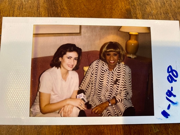 A Polaroid photograph of Naibe Reynoso and Celia Cruz from an interview in 1998. (Courtesy of Naibe Reynoso)