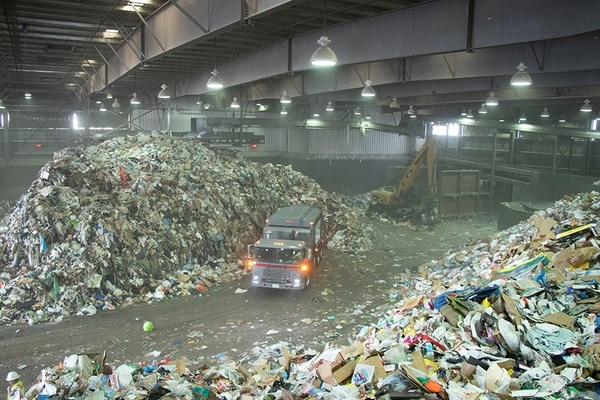 Tons of municipal wastes are piled up at a recycling center in Sun Valley. (Photo by Keyu Huang)