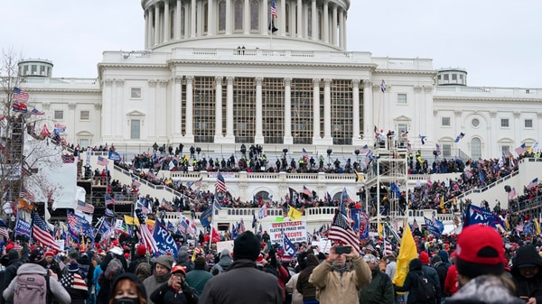 Trump supporters gather outside the Capitol, Wednesday, Jan. 6, 2021, in Washington. (AP Photo/Jose Luis Magana) (AP)