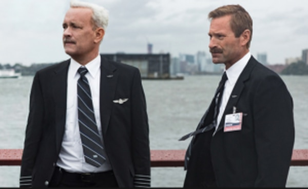 "Tom Hanks and Aaron Eckhart in ""Sully"" (Village Roadshow Pictures)."