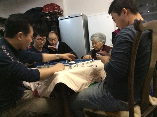 The Dong family plays mahjong during a family gathering in 2017.