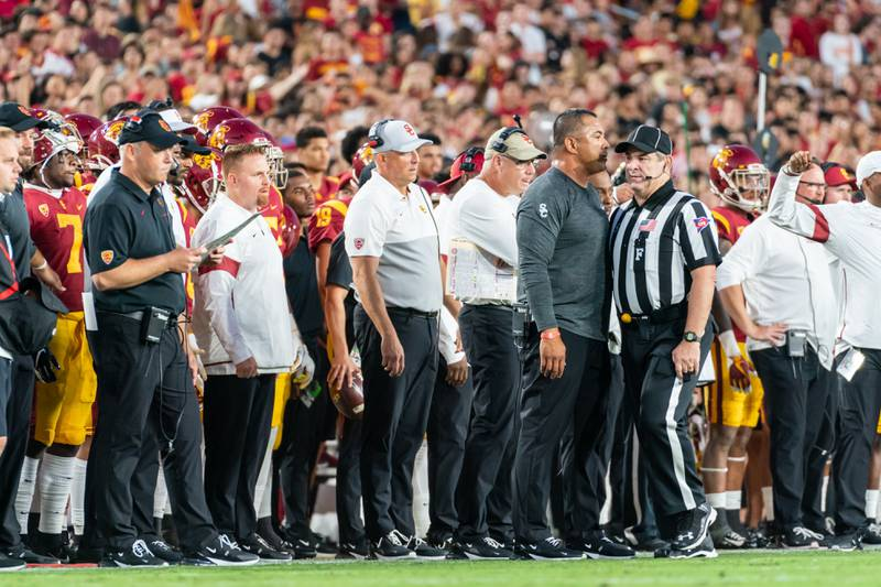 A photo of Clay Helton standing on the sideline at the Los Angeles Memorial Coliseum.