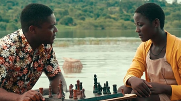 "David Oyelowo as Robert Katende and Madina Nalwanga as Phiona Mutesi in ""Queen of Katwe"" (Courtesy of Disney)."