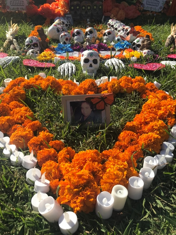 Jenny Morales grew up following the tradition of Día de los Muertos. This year she dedicated the altar to her father. (Credit Marcela Valdivia/Annenberg Media)