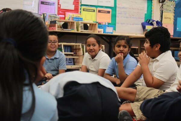 Second grade students circle up to discuss how to write their final showcase play. (Photo by Savannah Robinson)