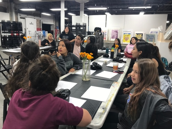 Girls from Las Fotos Project visited Self Help Graphics & Art to plan the elements of the Migrant Mamas Mural. (Photo by Marcela Valdivia)