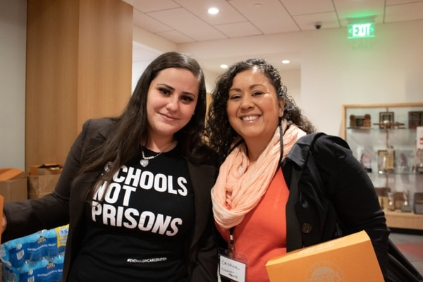 Graduate students Diana June-Greer (left) and Cristina Navarro-Aguirre (right) attend the conference to engage with their peers and hear President Carol Folt's speech.