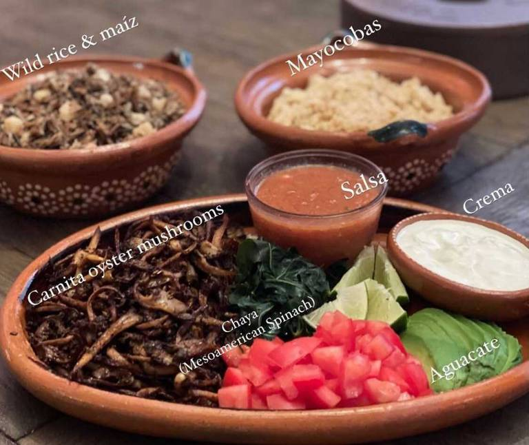 Photo of traditional dishes such as salsa, mushrooms, and wild rice handmade by Claudia Serrato