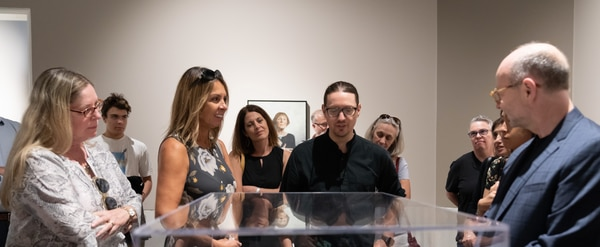 Visitors interact with art at Kassan's exhibit,