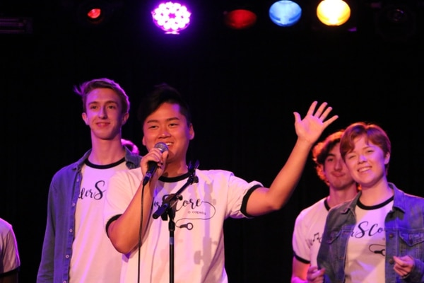 The a capella group UnderSCore performs at the ACA talent show. (Photo by Andy Chen)