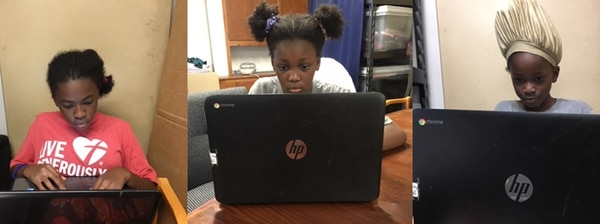 Ogun's daughters on their Google Chromebooks. (Photo courtesy of Folashade Ogun).