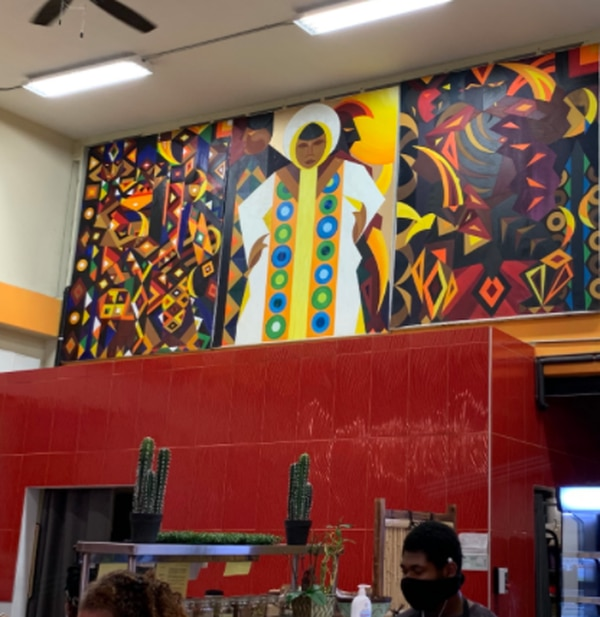 A mural on the wall of Hot and Cool Cafe. (Image courtesy of Camila Thur de Koos)
