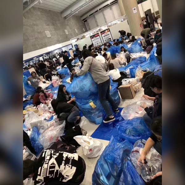 Purchasing agents, with goods that they are taking back to China, prepare for the journey at an airport in South Korea. (photo courtesy of Yiran Fang.)