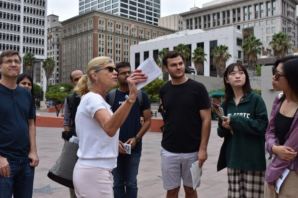 Los Angeles Conservancy architecture tour guide Lindsay McMenamin leads a group of USC students on a walking tour of Art Deco buildings downtown. Students attended the free tour sponsored by USC's Visions & Voices humanities and arts event series. (Photo by Rachel Parsons)