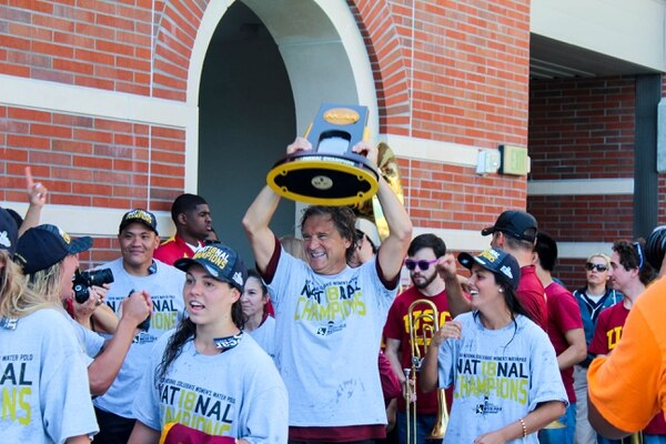 Head coach Jovan Vavic hoists up his 15th national title with USC. (Jodee Storm Sullivan/Annenberg Media)