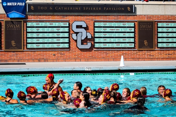 The team celebrates together in the pool. (Jodee Storm Sullivan/Annenberg Media)