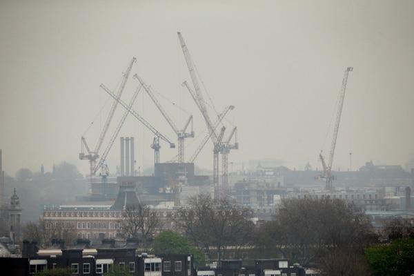 Cranes shrouded in smog as seen from Primrose Hill in London. (AP Photo/Matt Dunham, file)
