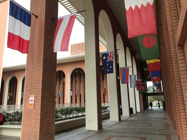 Flags of the world hang on the Von Kleinsmid Center on the campus of USC. ( Photo by Cara Heise)